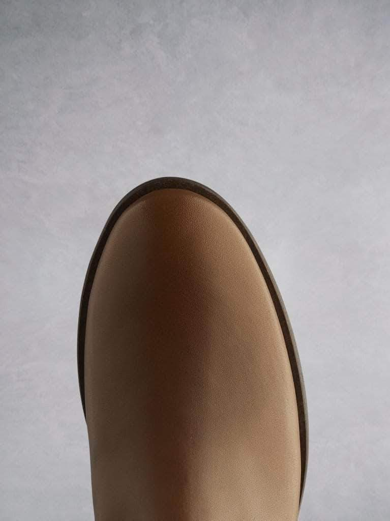 This tan ankle boot with a round toe shape, that complements the block heel.