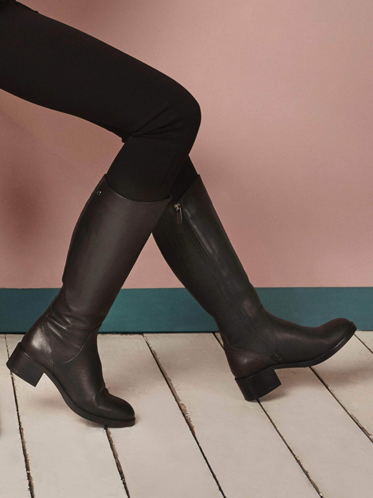 Kestrel in black leather, a riding-style boot with an asymmetric topline.