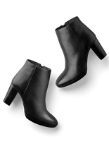 Loxton, a versatile black leather, high-heel ankle boot with a flattering shape.