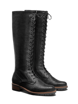 Marvel, a lace up knee high boot in black leather with stylish brogue detailing.