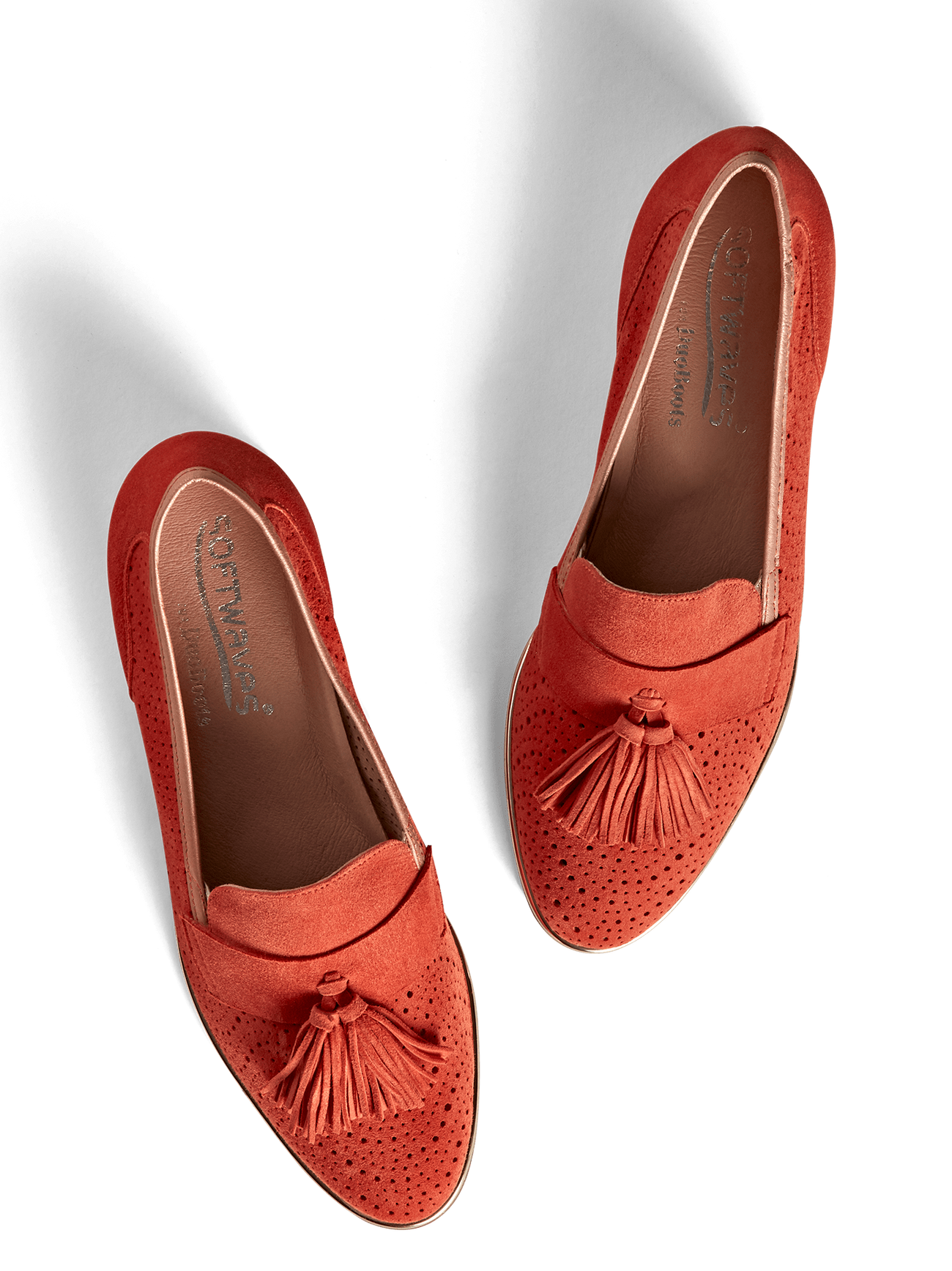 Milford, our flat sole tassel loafer, in perforated coral orange suede.