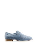 Mullion in chambray blue suede, a brogue shoe with a metallic gun metal trim.