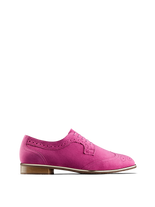 Mullion in fuchsia pink suede, a brogue shoe with a metallic gun metal trim.