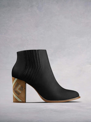 Stay on-trend in our unique Paragon Chelsea boot with hand stacked high block heel. Made from luxury black nubuck leather. Available in our standard or wide fit.