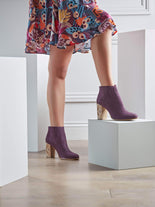 Paragon, a luxury ankle boot in purple nubuck with a statement patterned heel.