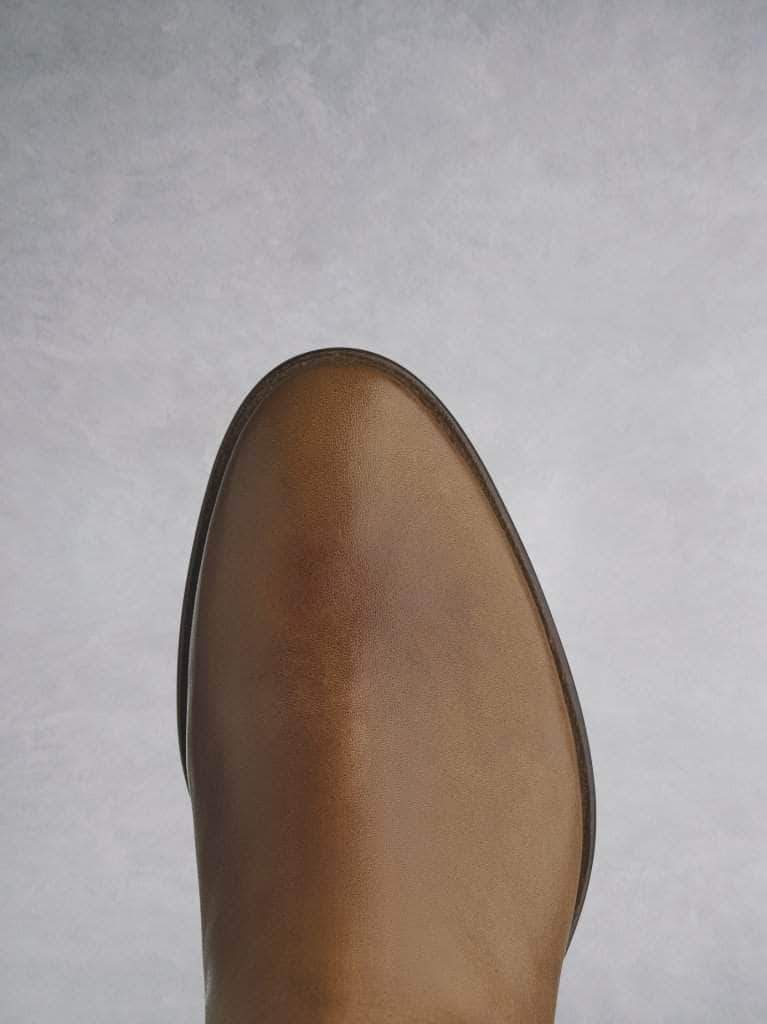 This tan boot has a smooth almond toe shape on a premium-look sole.
