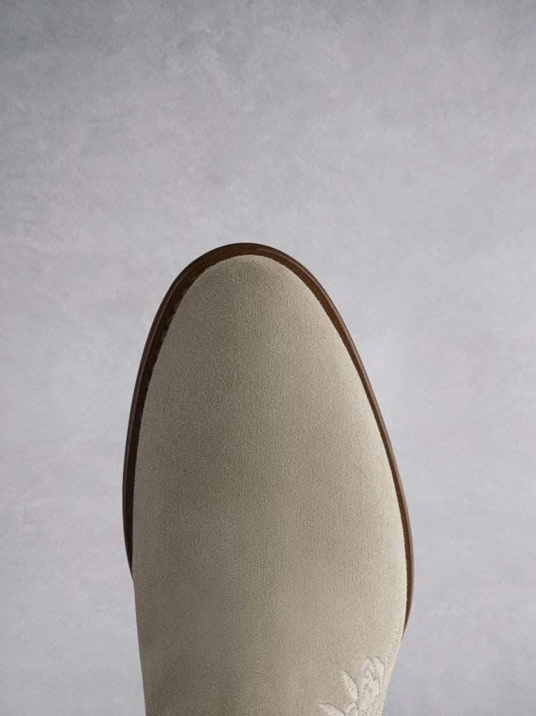 Paxton in taupe suede features an  almond toe shape on a premium sole.