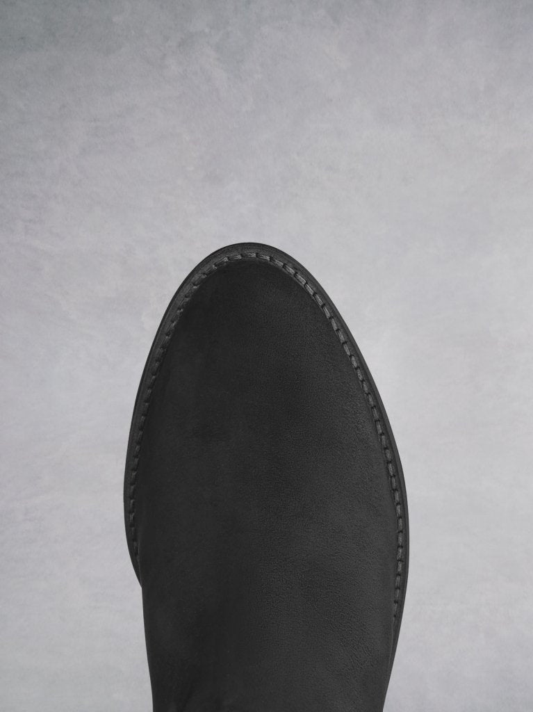 The black almond shaped toe complements the western inspired styling.