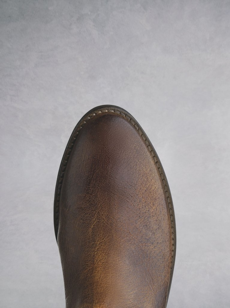 The tan almond shaped toe that complements the western style.