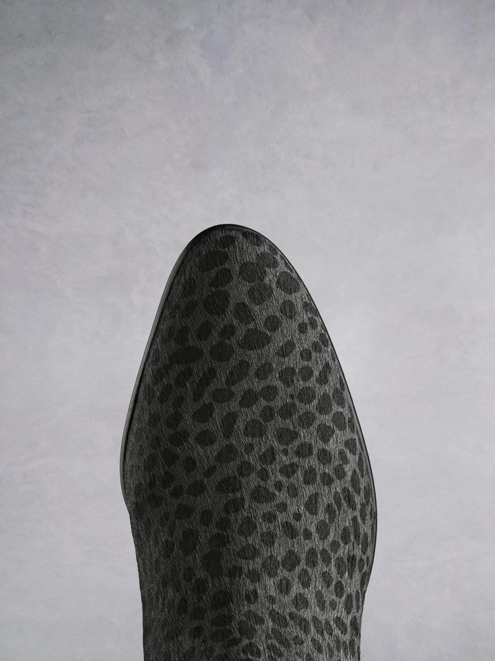 Renata, in grey leopard hair leather has a stylish almond toe shape.