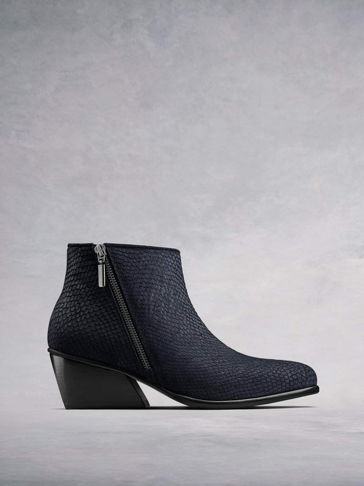 Renata, our on-trend ankle boot with angular heel and diagonal zip in navy snake embossed suede. Stand-out style. Available in our standard or wide fit ankle widths.