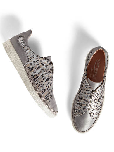 Ryde, a statement silver trainer with a safari print and central zip detailing.