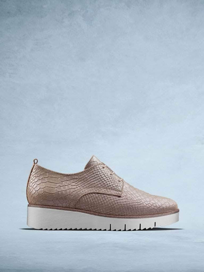 Sennen is our statement platform trainer made from rose mock croc leather.