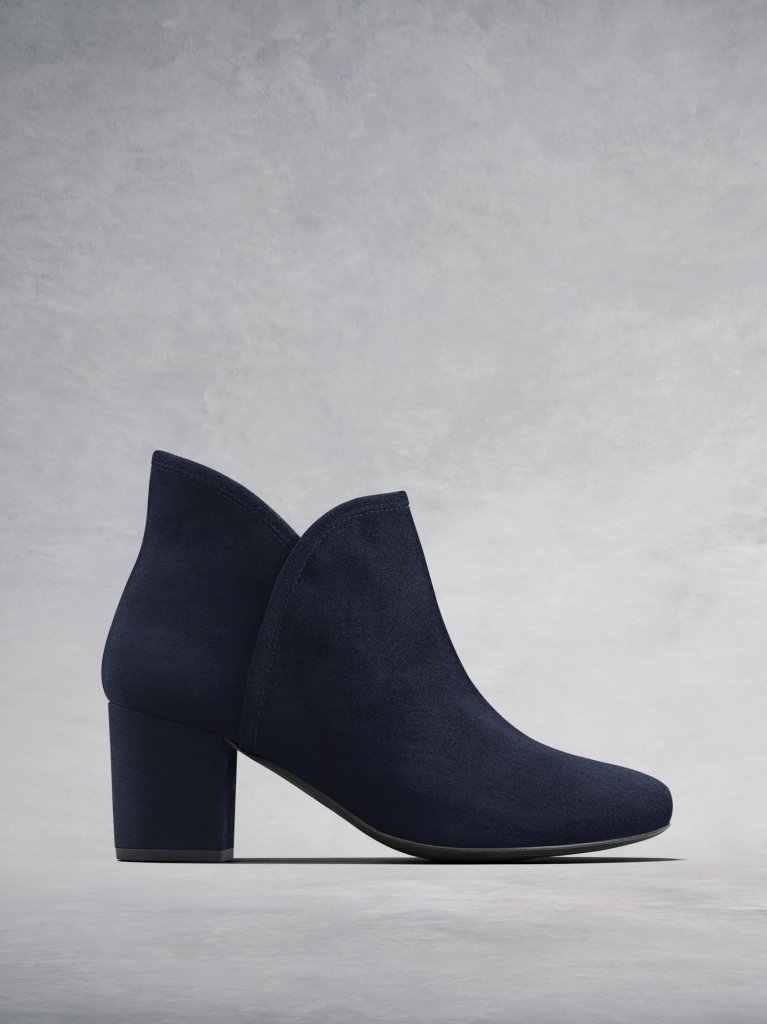 The Tigerlily, a versatile navy suede ankle boot with a sweetheart topline.