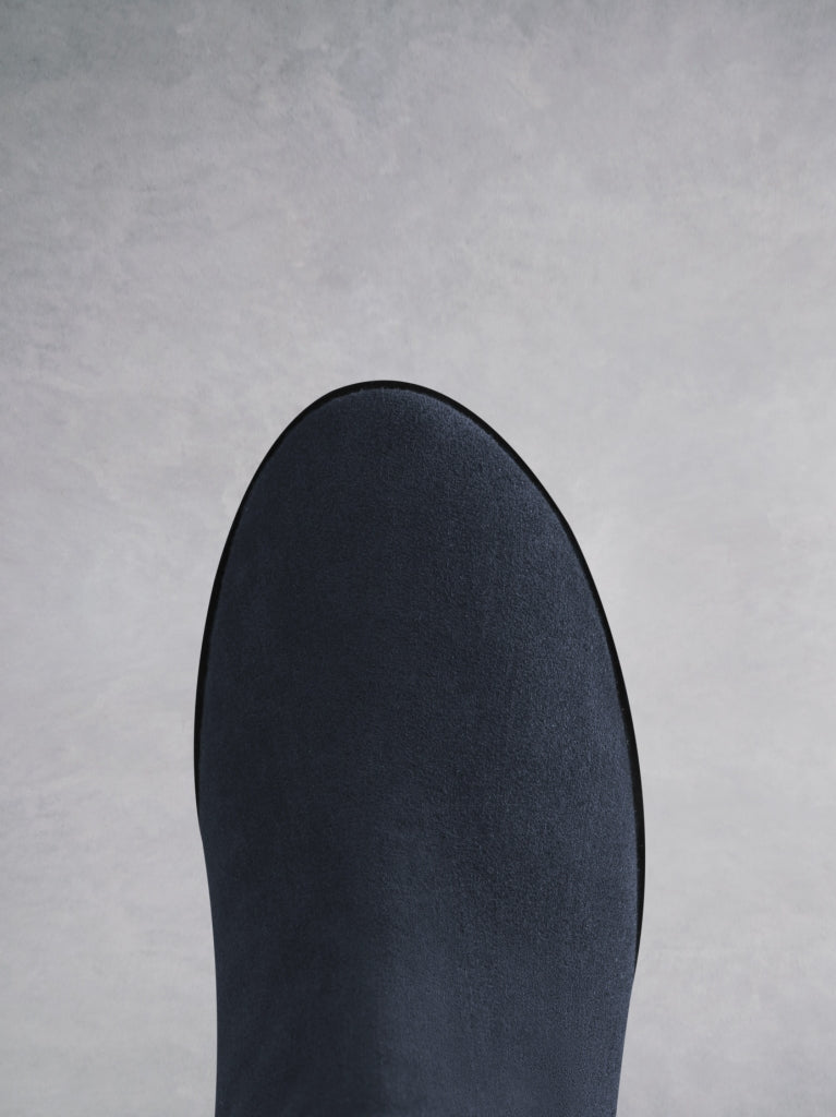 Featuring a practical round toe in navy suede on an E.V.A sole.