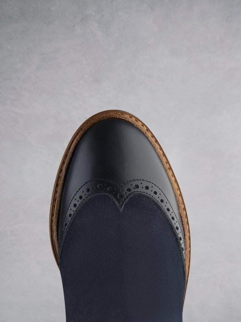 Featuring traditional brogue detailing over a round toe shape.