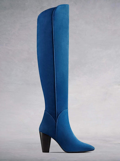Amery, our statement over the knee high heel boot in luxurious indigo blue kid suede with stylish detailing. Available in a range of calf sizes.