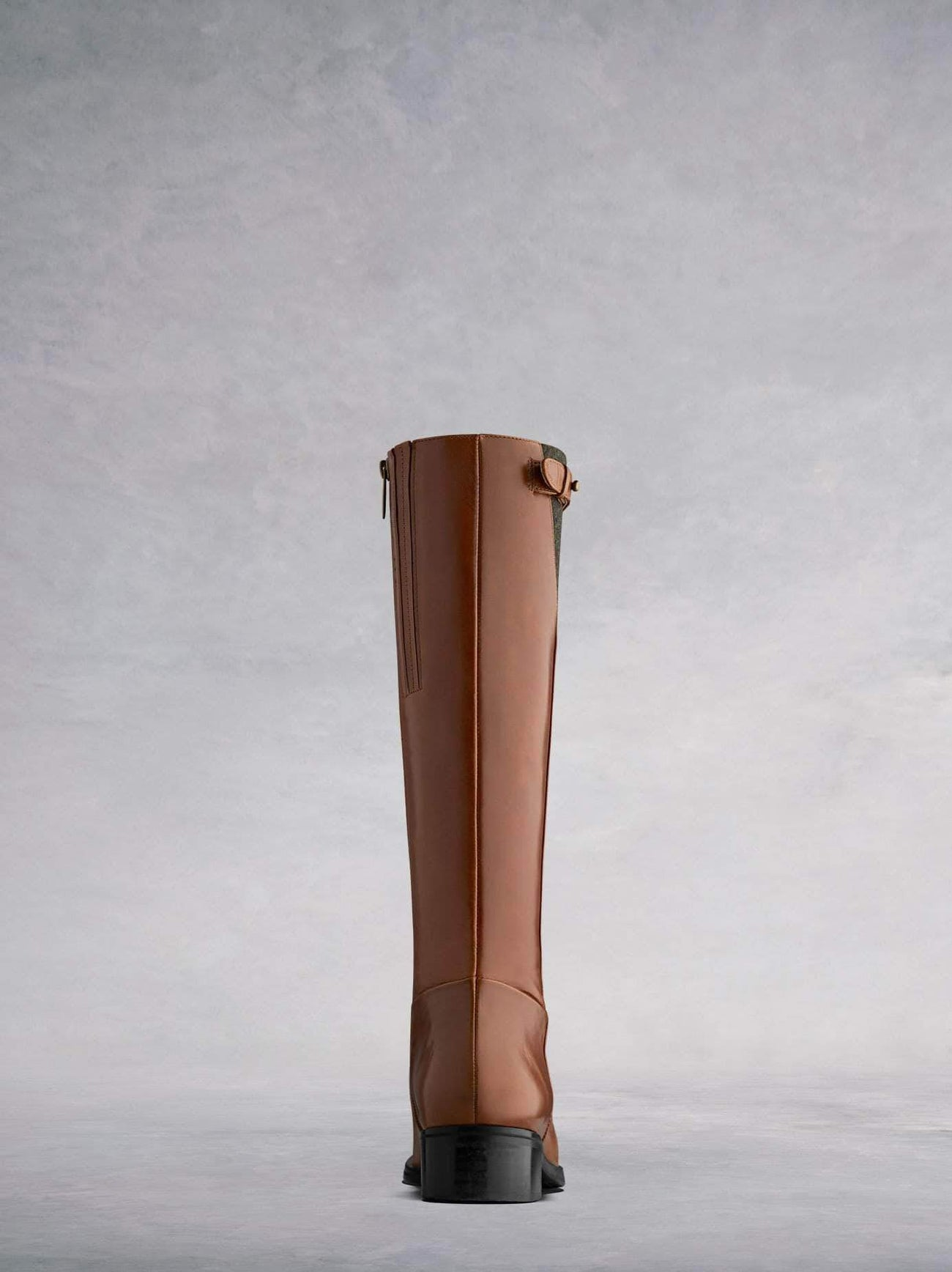 This tan knee high has a straight ankle perfect for women of all sizes.