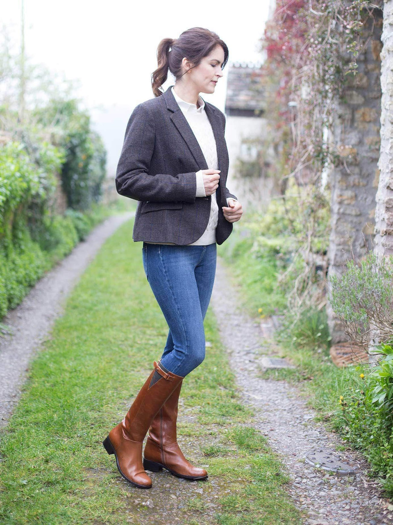 This flat tan boot has traditional sage green tweed detailing and a side strap.