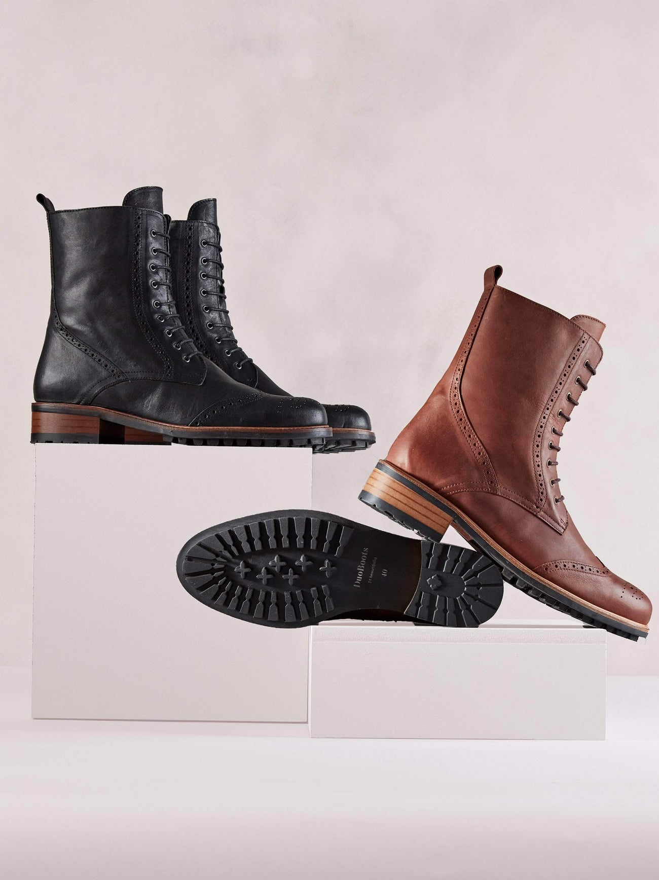 Chestnut leather ankle boot with a leather trim around the practical rubber tread sole.
