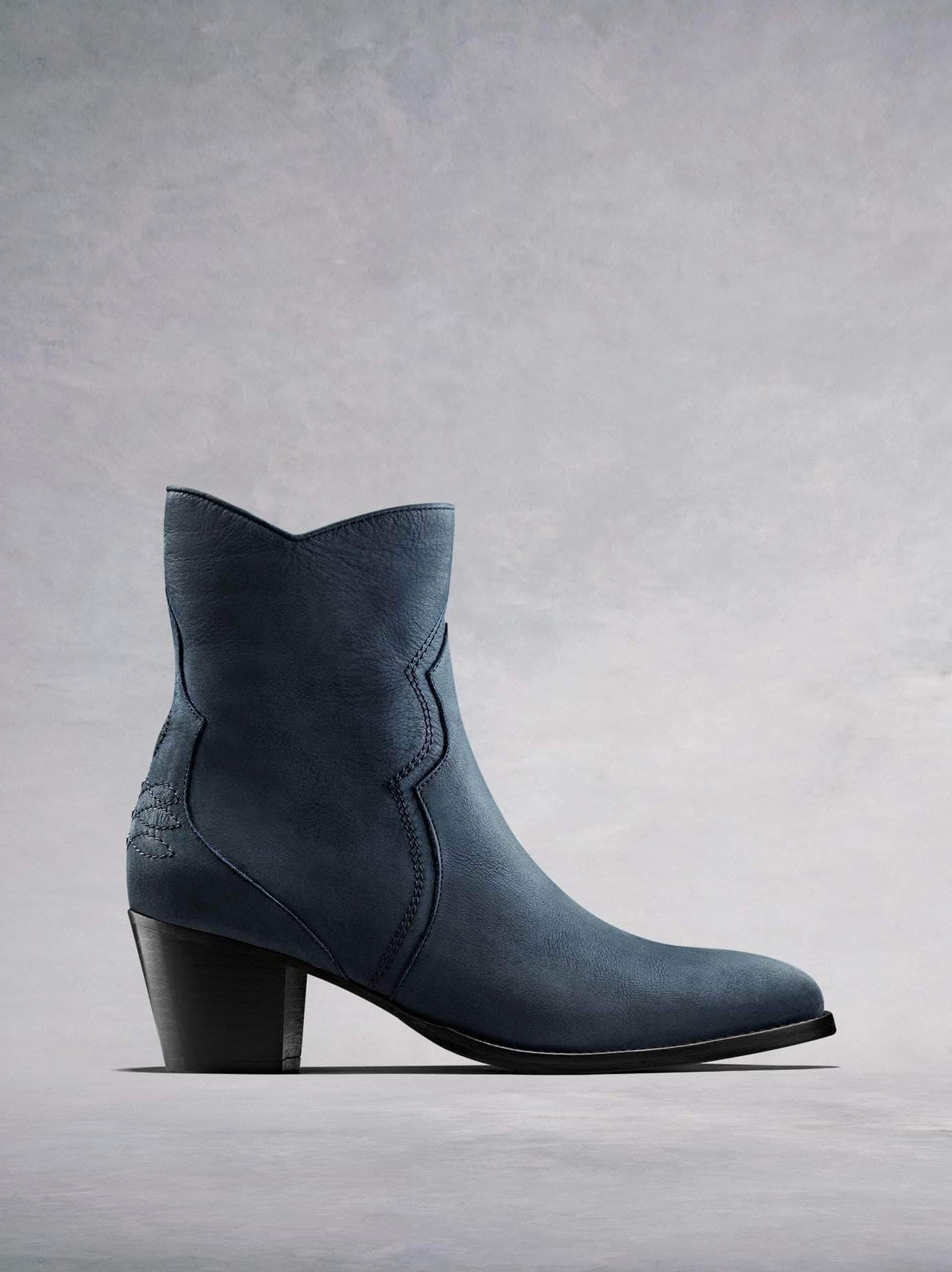Channel the Western trend with our Bexley petrol blue nubuck leather ankle boot. Available in our standard or wide fit.