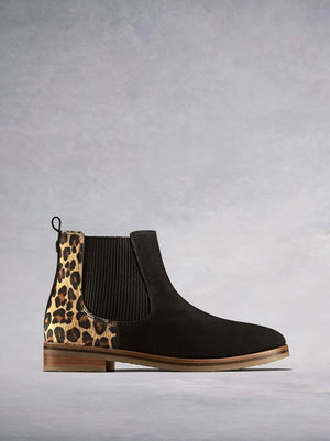 Darwin is a versatile black Chelsea ankle boot with a leopard print twist.