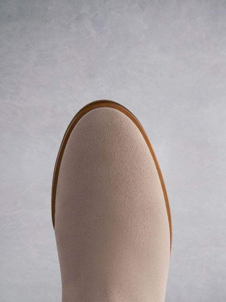 The Darwin pink has a comfortable round toe and a crepe look sole.