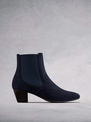 Edison, a modern take on a classic Chelsea boot in soft navy suede.