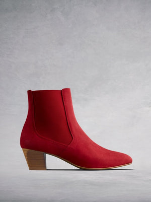 The Edison, a modern take on a classic Chelsea boot in soft red suede.