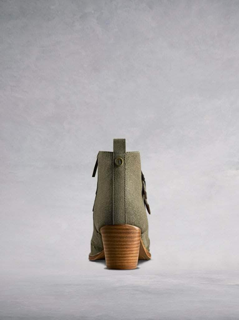 Our Emilia in khaki suede features a comfortable mid-height stacked Cuban heel.