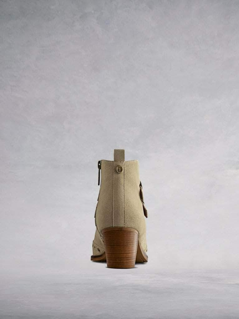 This taupe ankle boot features a comfortable mid-height stacked Cuban heel.