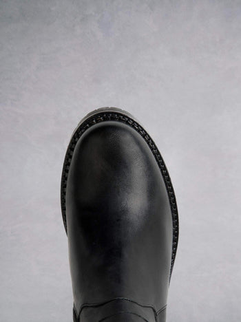 Finch Black Leather - Long leather boot with heavy tread sole and round toe.