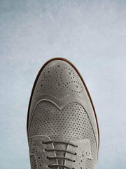 Featuring a stylish khaki almond toe complemented by brogue detailing.