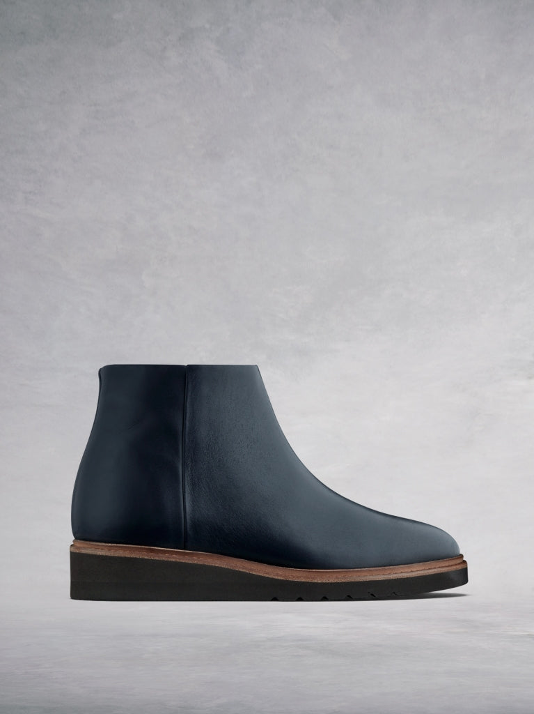 The Kielder, flat slide-on ankle boots in a luxurious navy leather.
