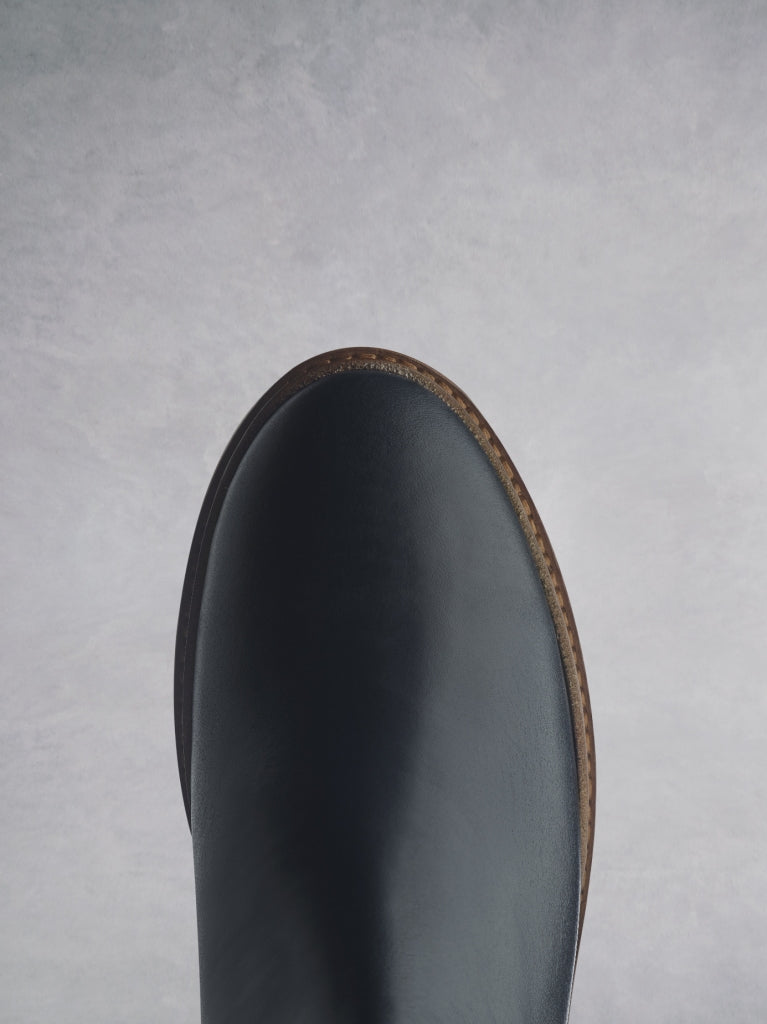 The Kielder has a navy round toe shape with a cushioned insole for comfort.