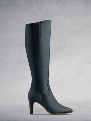 The Luxor, a versatile and timeless high heeled navy leather boot.