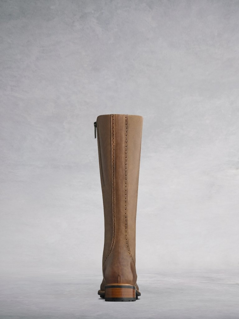 The Marvel in tan has a brown heel and black rubber tread sole.