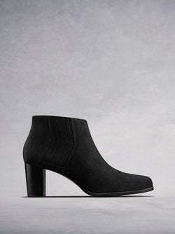 Miller Black Suede - Heeled ankle boot with zig-zag detailing.