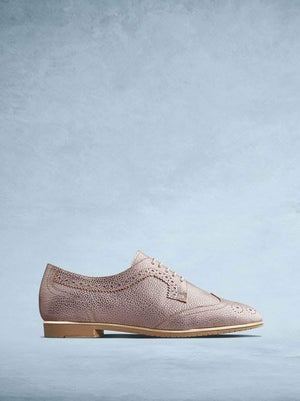 Mullion, our stylish lace-up brogue shoe, cut from rose gold leather.