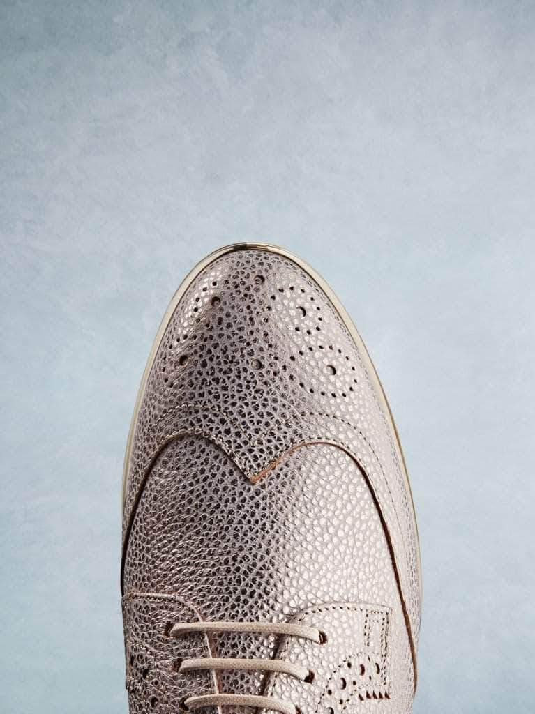 Brogue shoes in rose gold with an almond shaped toe.