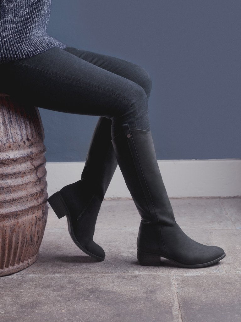 The staple black boot has a curved topline - both stylish and practical.