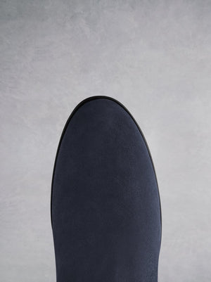 The Raven - a chic flat boot with a hidden wedge in velvety soft navy suede.