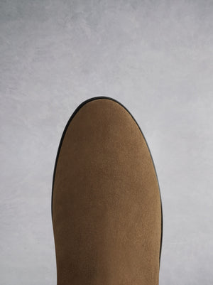 The Raven - a chic flat boot with a hidden wedge in velvety soft tan suede.