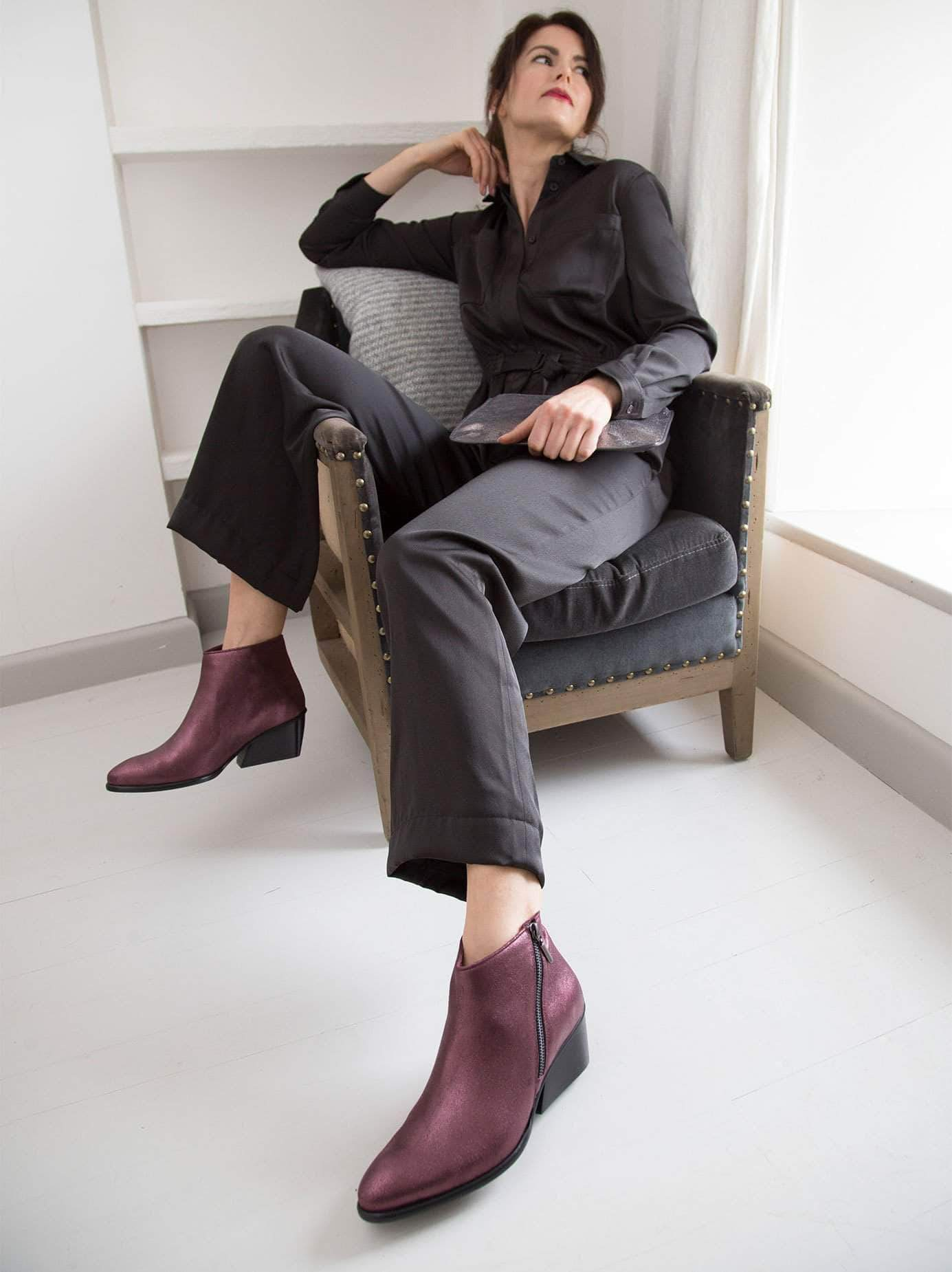 Renata, our plum metallic leather ankle boot with an angular heel shape.