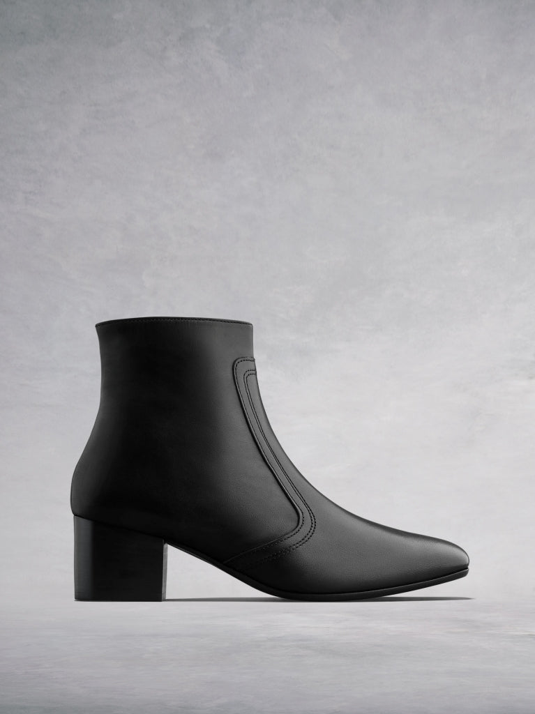 The Shimmer - an elegant square toed ankle boot in black leather.