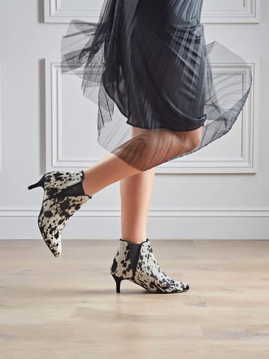 Our Somerton kitten heel Chelsea boot, go bold in cow print hair leather.