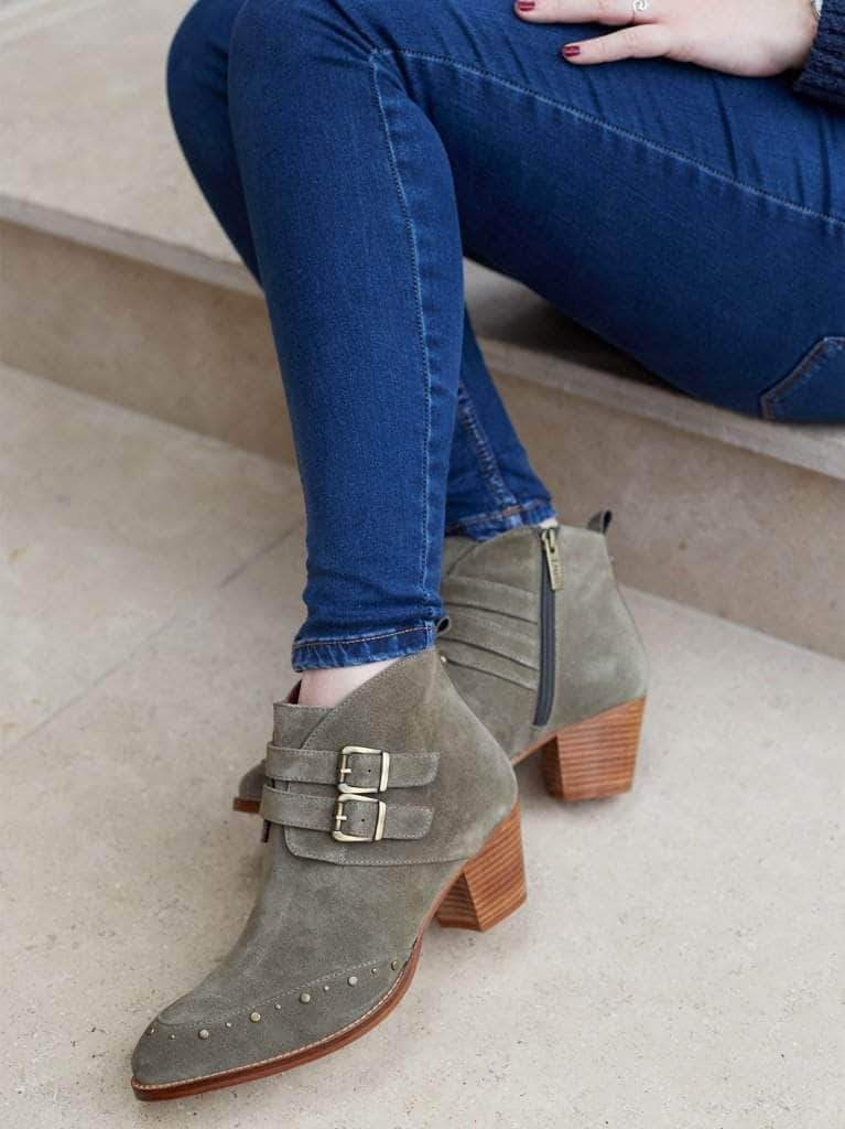 This khaki ankle boot has two buckled suede straps, finished with a luxe leather lining.