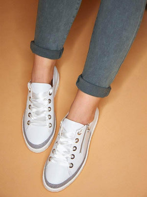 Harlyn is our lace-up white leather trainer with a side zip.