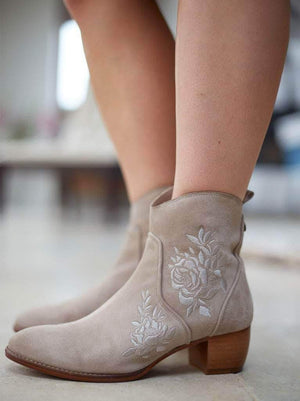 Paxton, our embroidered taupe suede western-inspired ankle boot.