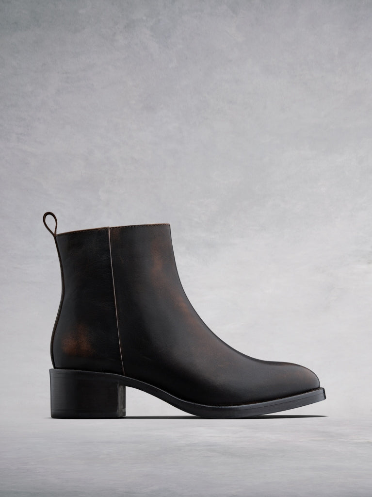 Arietty, a timeless brown leather ankle boot with a classic silhouette.